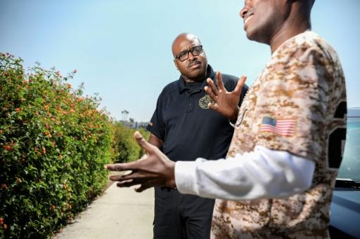 San Diego Police officer Ben Kelso, 53, speaks with a local resident at the city's Paradise Valley Park on June 12
