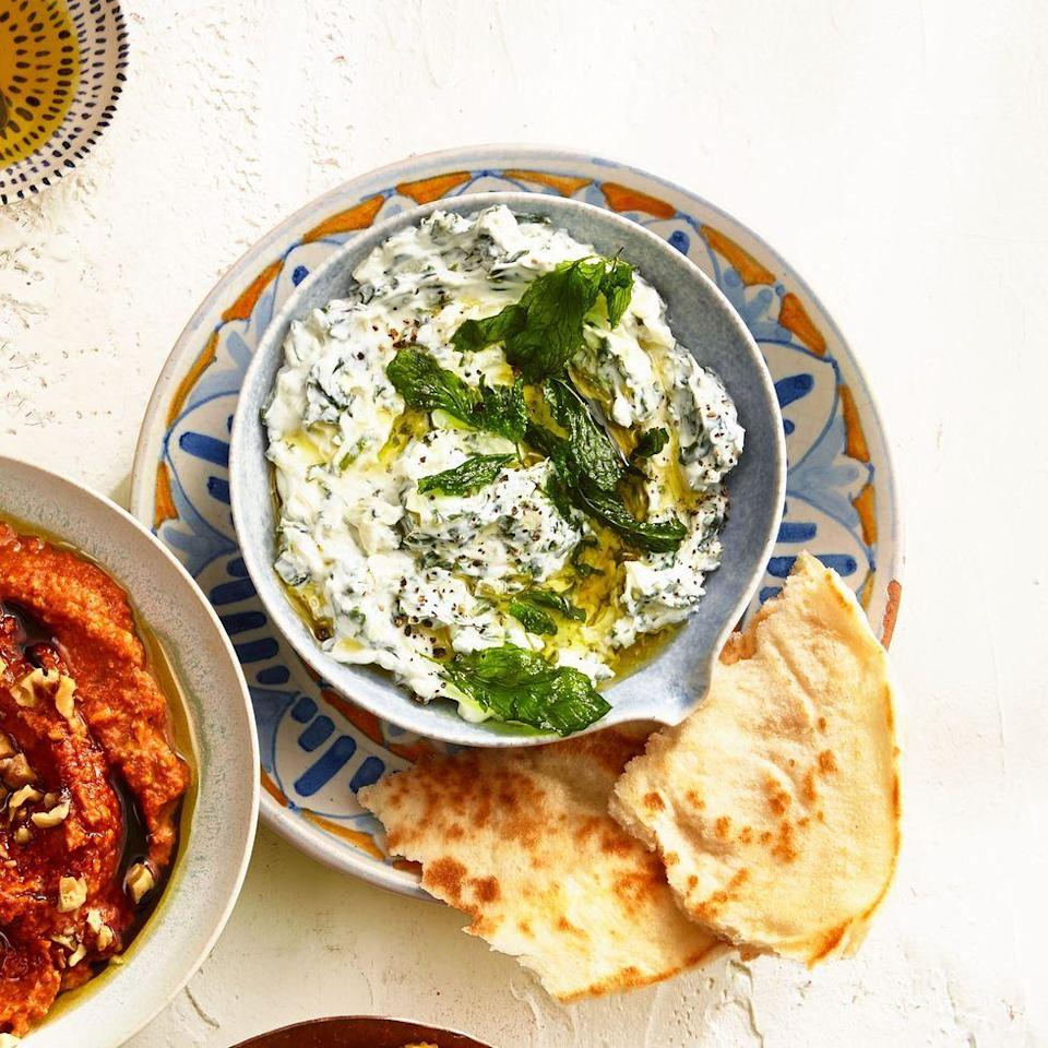 """<p>A healthy take on spinach and artichoke dip, this Iranian-inspired spread leans on Greek yogurt and lemon zest for extra tang. </p><p><em><a href=""""https://www.goodhousekeeping.com/food-recipes/a34975164/spinach-yogurt-dip-recipe/"""" rel=""""nofollow noopener"""" target=""""_blank"""" data-ylk=""""slk:Get the recipe for Spinach and Yogurt Dip »"""" class=""""link rapid-noclick-resp"""">Get the recipe for Spinach and Yogurt Dip »</a></em></p>"""