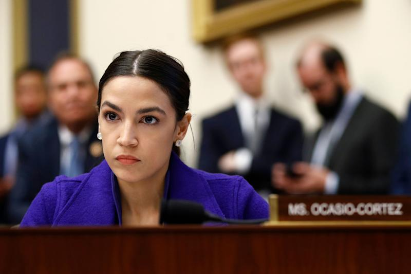 "FILE - In this Wednesday, April 10, 2019, file photo, Rep. Alexandria Ocasio-Cortez, D-N.Y., listens during a House Financial Services Committee hearing with leaders of major banks on Capitol Hill in Washington. Tom Ferrall, chairman of the Ohio College Republican Federation and a senior at the University of Dayton, has apologized for a fundraising email that referred to Democratic congresswoman Alexandria Ocasio-Cortez as a ""domestic terrorist."" (AP Photo/Patrick Semansky, File)"