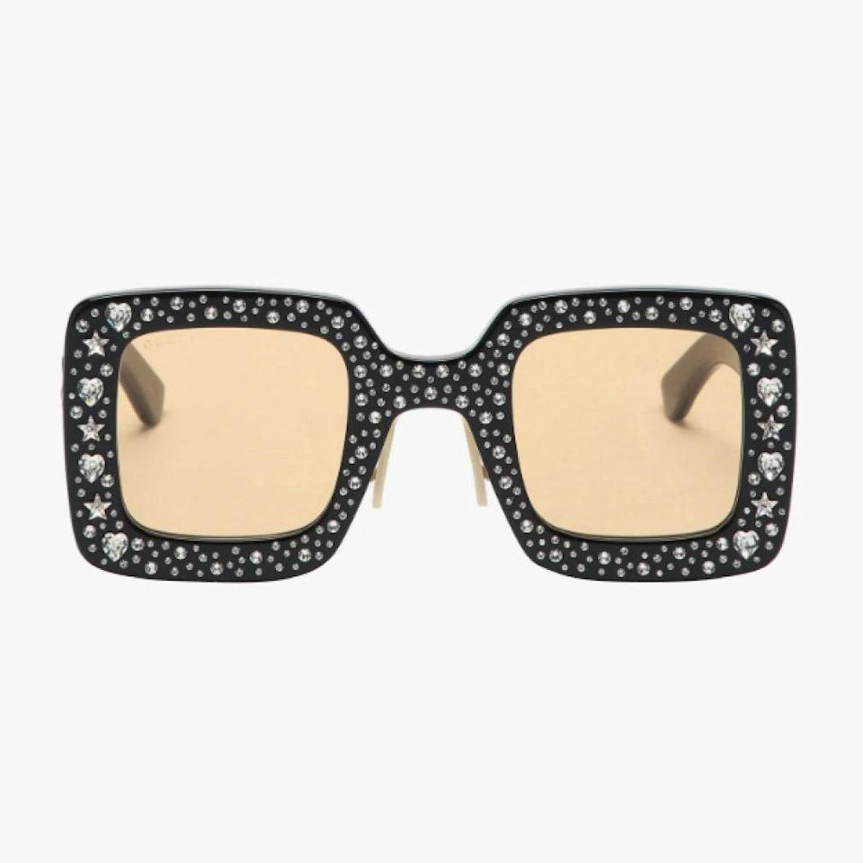 """$1375, MATCHESFASHION.COM. <a href=""""https://www.matchesfashion.com/us/products/Gucci-Crystal-embellished-square-acetate-sunglasses-1389008"""" rel=""""nofollow noopener"""" target=""""_blank"""" data-ylk=""""slk:Get it now!"""" class=""""link rapid-noclick-resp"""">Get it now!</a>"""