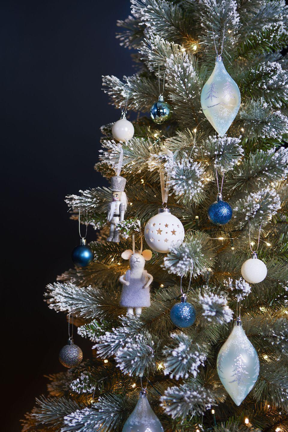 """<p>As part of their Nordic Blues trend, this range has hues of blue and silver to give your <a href=""""https://www.housebeautiful.com/uk/decorate/a34844572/easy-decorate-christmas-tree-free/"""" rel=""""nofollow noopener"""" target=""""_blank"""" data-ylk=""""slk:Christmas tree"""" class=""""link rapid-noclick-resp"""">Christmas tree</a> a fresh feel. From olive-shaped light blue baubles (£3) to their famous mouse figurine (£3.50), there's something for every home. </p><p>'Taking inspiration from the icy glaciers of Scandinavia, the Nordic Blues trend features a cool colour palette together with sparkling finishes, to bring a touch of elegance into the home,' say Tesco. </p>"""