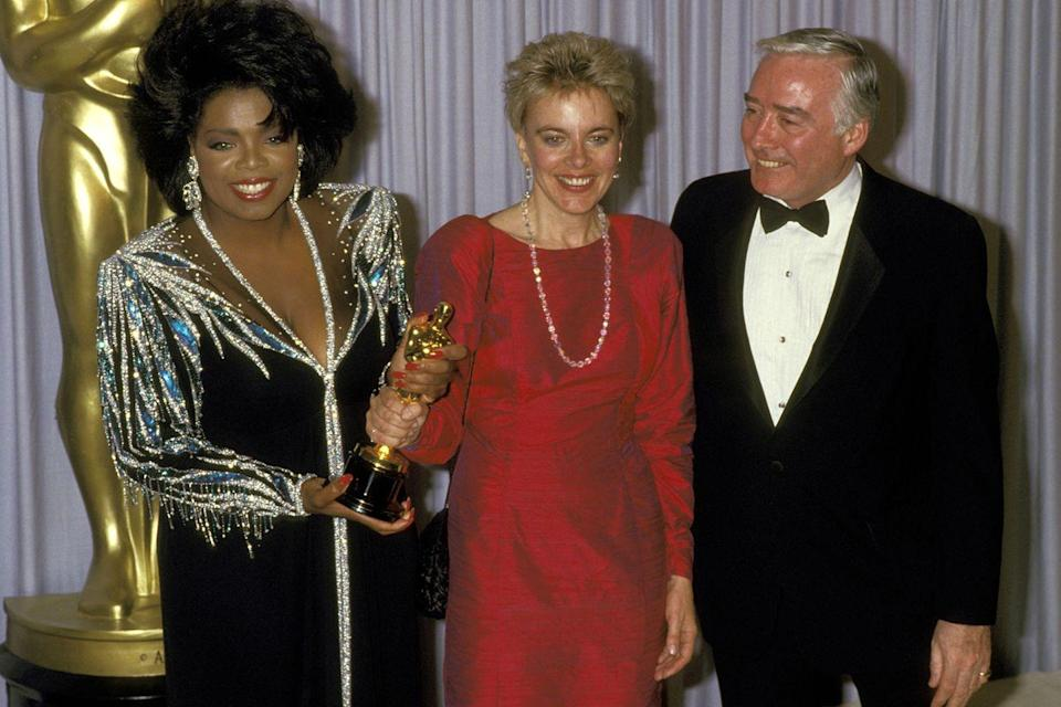 <p>Oprah and documentarian Brigitte Berman held the Best Documentary Feature Oscar backstage, which Berman won for <em>Artie Shaw: Time Is All You've Got</em>.</p>