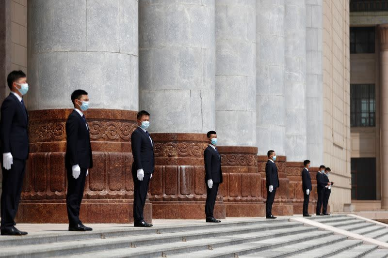 Security personnel stand guard outside the Great Hall of the People in Beijing