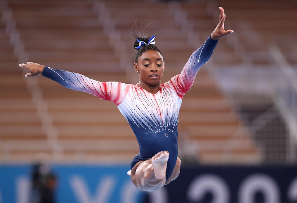 Simone Biles competes in the women's balance beam final at the 2020 Tokyo Olympics.