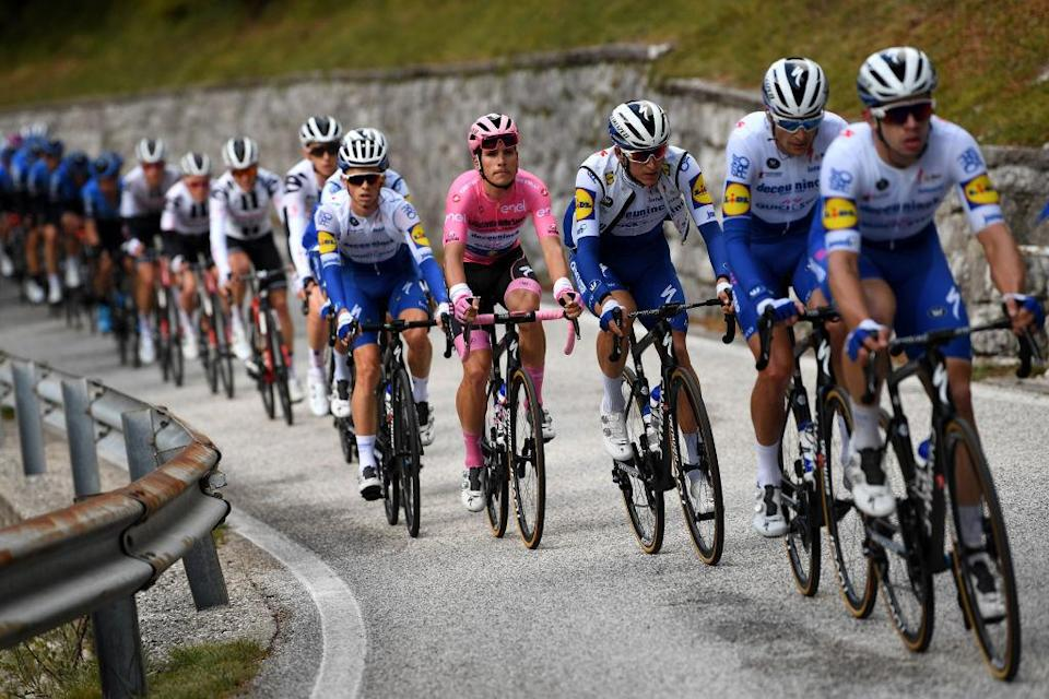 PIANCAVALLO ITALY  OCTOBER 18 James Knox of The United Kingdom and Team Deceuninck  QuickStep  Joao Almeida of Portugal and Team Deceuninck  QuickStep Pink Leader Jersey  Mikkel Honore of Denmark and Team Deceuninck  QuickStep  Peloton  during the 103rd Giro dItalia 2020 Stage 15 a 185km stage from Base Aerea Rivolto  Frecce Tricolori to Piancavallo 1290m  girodiitalia  Giro  on October 18 2020 in Piancavallo Italy Photo by Tim de WaeleGetty Images