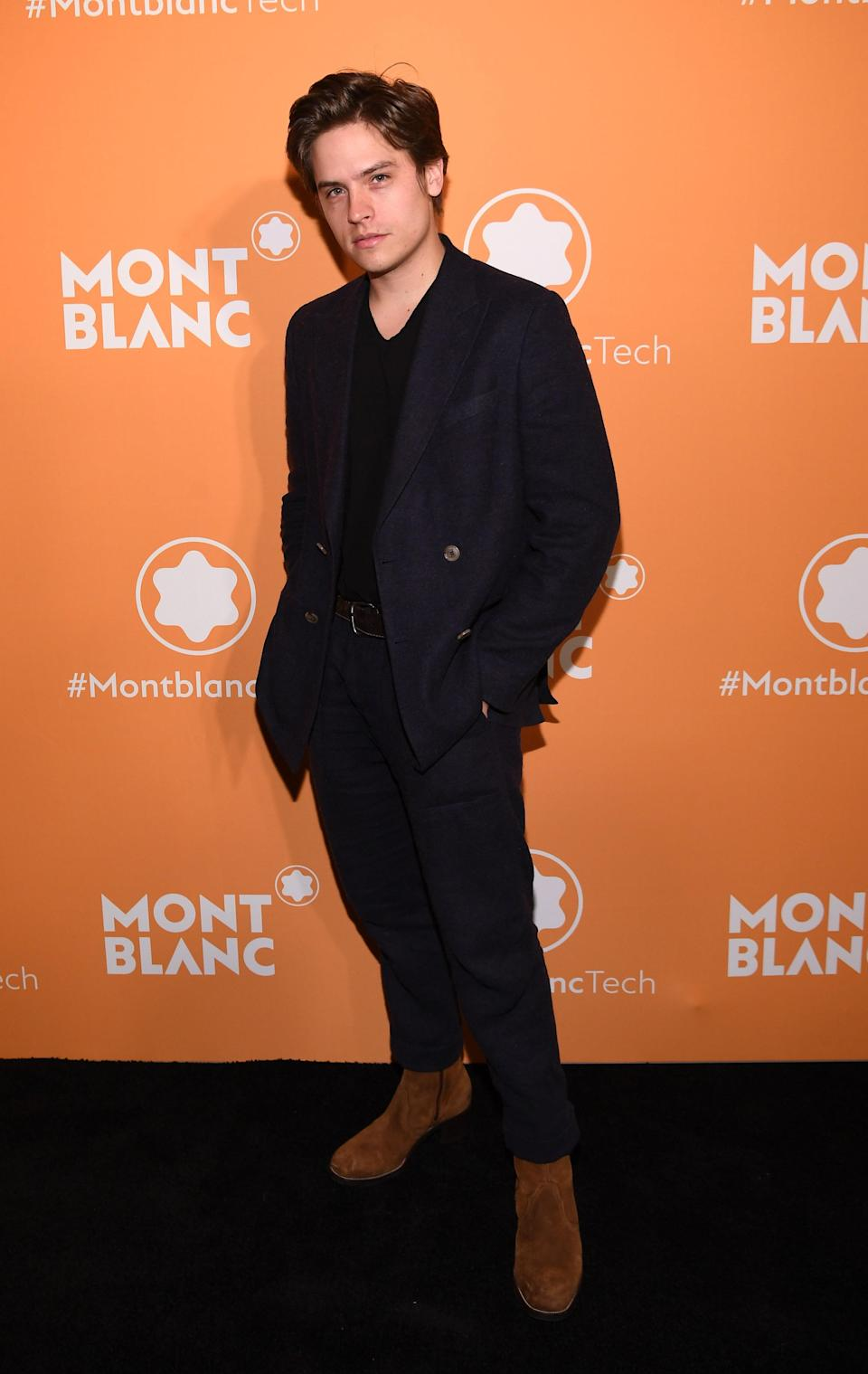 <p>WHERE: A Montblanc event in New York City </p> <p>WHEN: March 10, 2020 </p> <p>WHY: With suede boots and a t-shirt, Sprouse makes a DB suit look nice and comfy. </p>