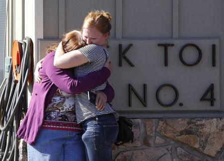 FILE PHOTO:    College alumnus is embraced after a mass shooting at Umpqua Community College in Roseburg