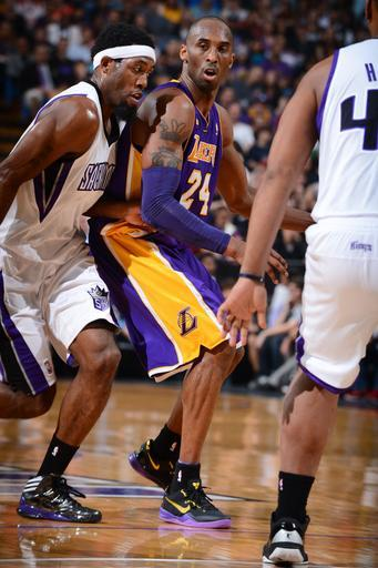 SACRAMENTO, CA - MARCH 30: Kobe Bryant #24 of the Los Angeles Lakers dribbles the ball against John Salmons #5 of the Sacramento Kings on March 30, 2013 at Sleep Train Arena in Sacramento, California. (Photo by Garrett Ellwood/NBAE via Getty Images)