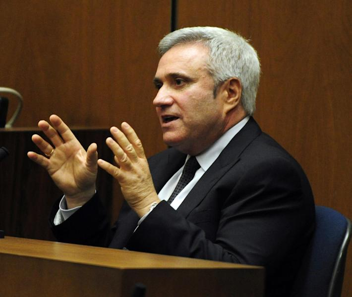 """FILE - This Oct. 25, 2011 file photo shows Randy Phillips, Chief Executive of AEG Live and promoter of Michael Jackson's """"This Is It"""" concert tour, testifying at the Conrad Murray involuntary manslaughter trial in Los Angeles. A judge dismissed two top AEG Live LLC executives, Phillips and Paul Gongaware, from a negligent hiring lawsuit filed by Jackson's mother, Katherine Jackson, on Monday Sept. 9, 2013. The Los Angeles trial is nearing its end after 20 weeks of testimony and legal arguments that have offered an in-depth portrait of Jackson's preparations for his ill-fated """"This Is It"""" concerts. (AP Photo/Paul Buck, Pool, File)"""