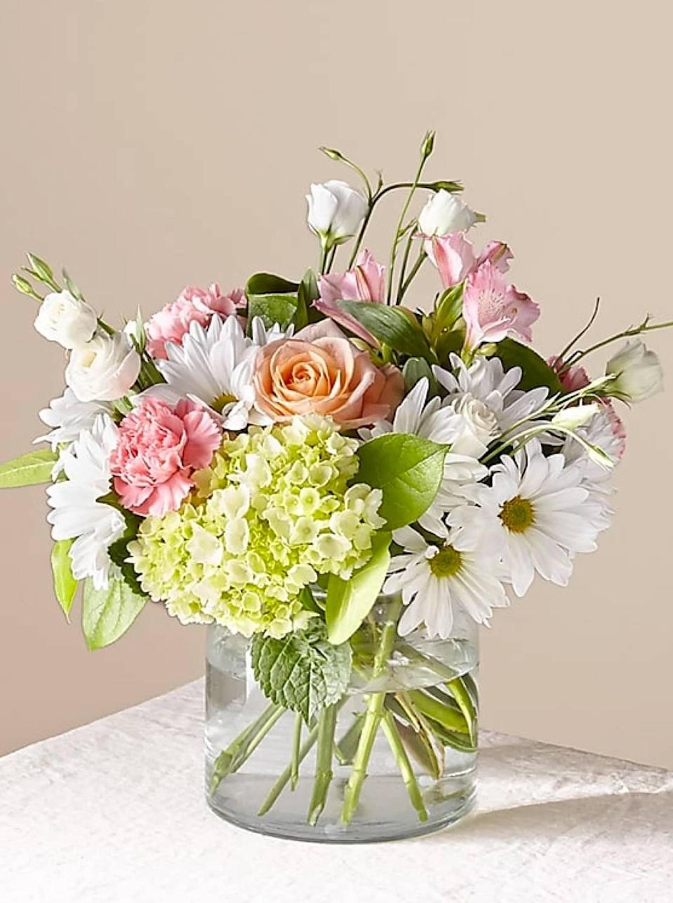 """ProFlowers lets you send flowers by date and zip code, so on-time delivery is guaranteed. The service curates options for different occasions—think birthday milestones, housewarmings, or """"Just Because"""" bouquets. Once you find a fitting pick, you can order it in whatever size meets your budget. $72, Flutter By Bouquet. <a href=""""https://www.proflowers.com/product/flutter-by-bouquet-prd-21-s2?"""" rel=""""nofollow noopener"""" target=""""_blank"""" data-ylk=""""slk:Get it now!"""" class=""""link rapid-noclick-resp"""">Get it now!</a>"""