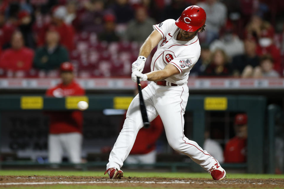 Cincinnati Reds' Max Schrock hits a triple against the Washington Nationals during the ninth inning of a baseball game Thursday, Sept. 23, 2021, in Cincinnati. The Nationals beat the Reds 3-2. (AP Photo/Jay LaPrete)