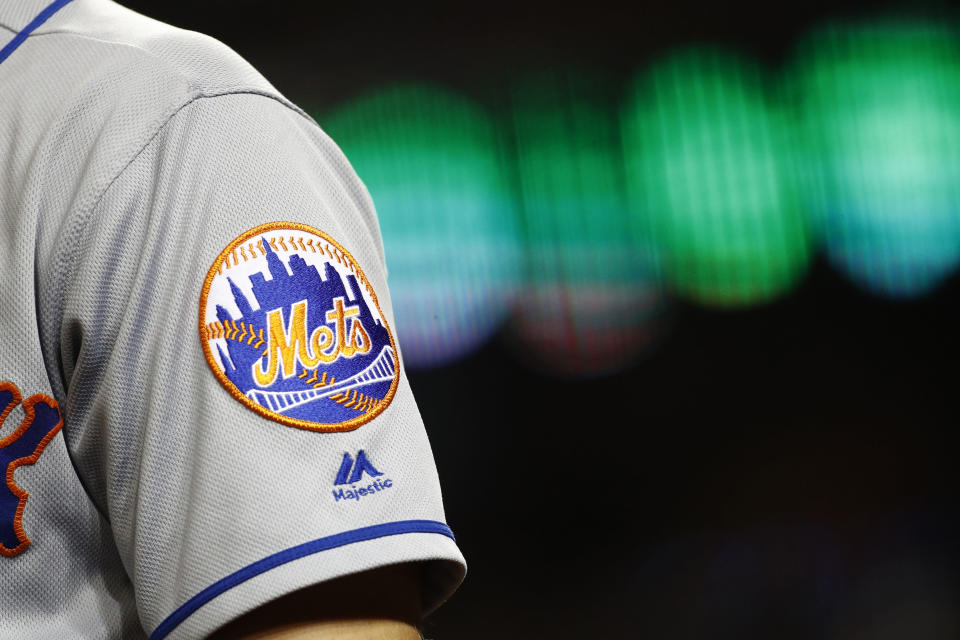 FILE - In this Sept. 3, 2019, file photo, the New York Mets logo is seen on Brandon Nimmo's sleeve as he prepares for an at-bat during a baseball game against the Washington Nationals in Washington. Major League Baseball owners voted Friday, Oct. 30, 2020, to approve the sale of the New York Mets to billionaire hedge fund manager Steve Cohen. The sale from the Wilpon and Katz families values the franchise at between $2.4 billion and $2.45 billion, a record for a baseball team. The sale is likely to close within 10 days.(AP Photo/Patrick Semansky, File)
