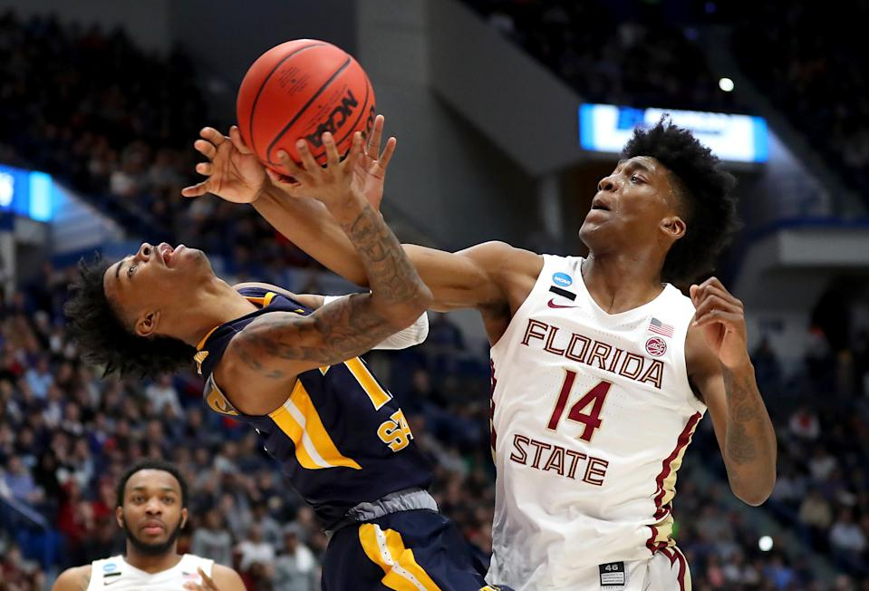 <p>Ja Morant #12 of the Murray State Racers and Terance Mann #14 of the Florida State Seminoles battle for the ball in the second half during the second round of the 2019 NCAA Men's Basketball Tournament at XL Center on March 23, 2019 in Hartford, Connecticut. (Photo by Maddie Meyer/Getty Images) </p>