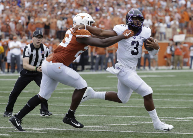 TCU quarterback Shawn Robinson (3) is sacked for a loss by Texas linebacker Jeffrey McCulloch (23) during the first half of an NCAA college football game, Saturday, Sept. 22, 2018, in Austin, Texas. (AP Photo/Eric Gay)