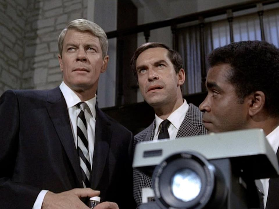 """LOS ANGELES - FEBRUARY 23: Peter Graves as James Phelps, Martin Landau as Rollin Hand and Greg Morris as Barney Collier in the Mission Impossible episode, """"Live Bait""""  Original airdate, February 23, 1969.  Image is a frame grab.  (Photo by CBS via Getty Images)"""