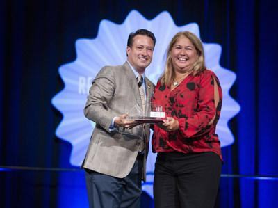 2019 Florida Realtors® President Eric Sain presents Christine Hansen with her award as 2019 Realtor of the Year during the state association's awards luncheon at its recent convention and trade expo in Orlando. Hansen was president of Florida Realtors in 2018.