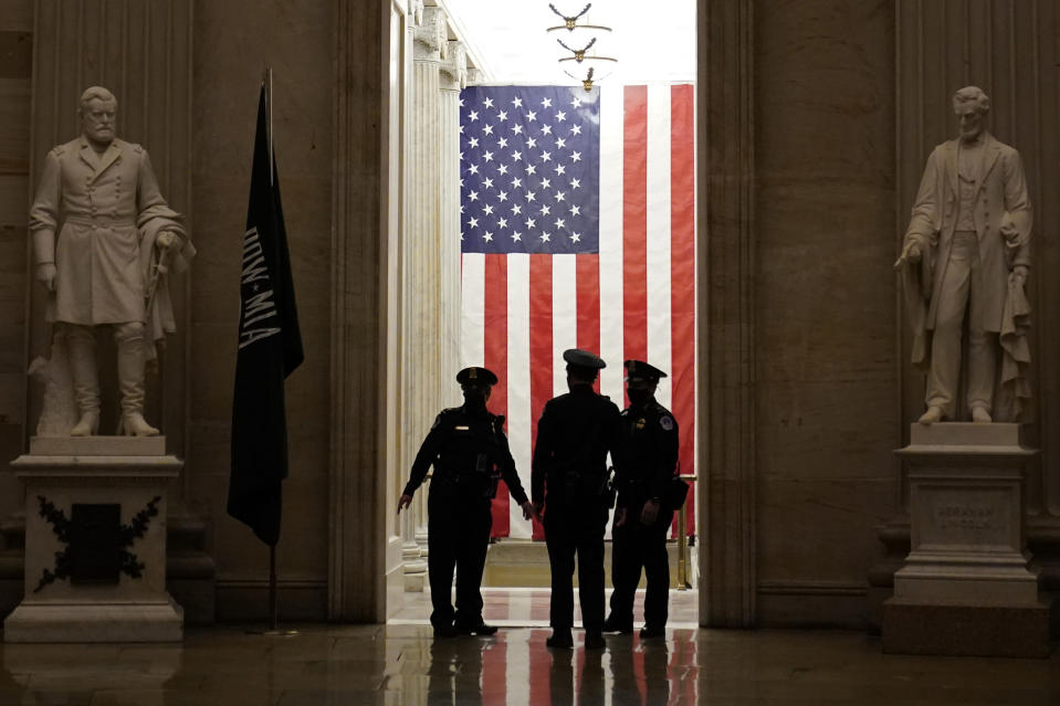 Capitol Police officers talk in the Capitol Rotunda on Capitol Hill in Washington, Monday evening, Jan. 25, 2021. (AP Photo/Susan Walsh)