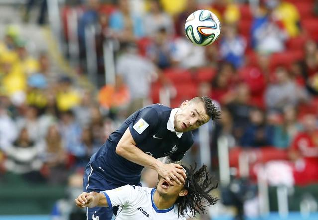 France's Mathieu Debuchy fights with Roger Espinoza of Honduras for the ball during their 2014 World Cup Group E soccer match at the Beira-Rio stadium in Porto Alegre June 14, 2014. REUTERS/Murad Sezer (BRAZILSOCCER CUP - Tags: SPORT SOCCER WORLD CUP TPX IMAGES OF THE DAY)