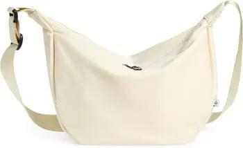 <p>We don't know who needs to hear this, but it's totally fine to wear white after Labor Day. With a cool, slouchy silhouette, this <span>Street Level Half Moon Nylon Crossbody Bag</span> ($40) is the perfect way to rewrite the fashion rules.</p>