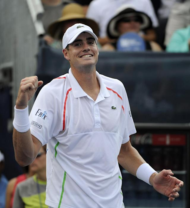 John Isner, of the United States, smiles after defeating Dudi Sela, of Israel, in the Atlanta Open tennis tournament final on Sunday, July 27, 2014, in Atlanta. Isner won 6-3, 6-4. (AP Photo/David Tulis)