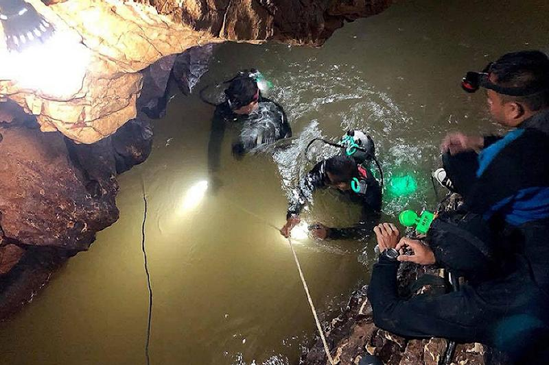 Royal Thai Navy SEAL divers inspect a water-filled tunnel in the Tham Luang cave (AFP/Getty Images)