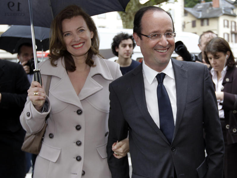 French Socialist Party candidate for the presidential election Francois Hollande and his companion French journalist Valerie Trierweiler, visit the market in Tulle, southwestern France, on the eve of the presidential election second round, Saturday, May 5, 2012.(AP Photo/Lionel Cironneau)