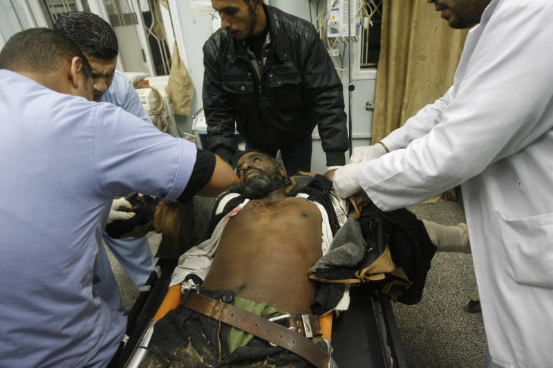 Medics treat a wounded Palestinian militant at Al Najar hospital following an Israeli air strike in Rafah, southern Gaza Strip, Saturday, Oct. 29, 2011. Israeli aircraft struck at Palestinian militants in Gaza on Saturday who responded with a volley of rockets which rained on southern Israeli towns, Israeli and Palestinian officials said.  (AP Photo/Eyad Baba)