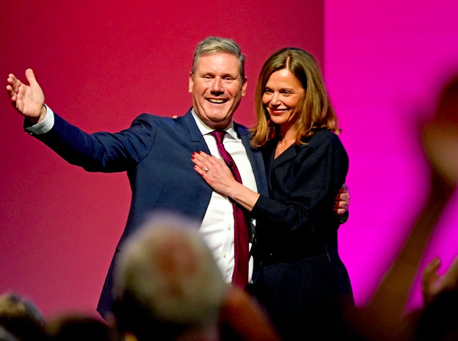 Sir Keir Starmer poses with wife Victoria at the end of his speech. (PA)