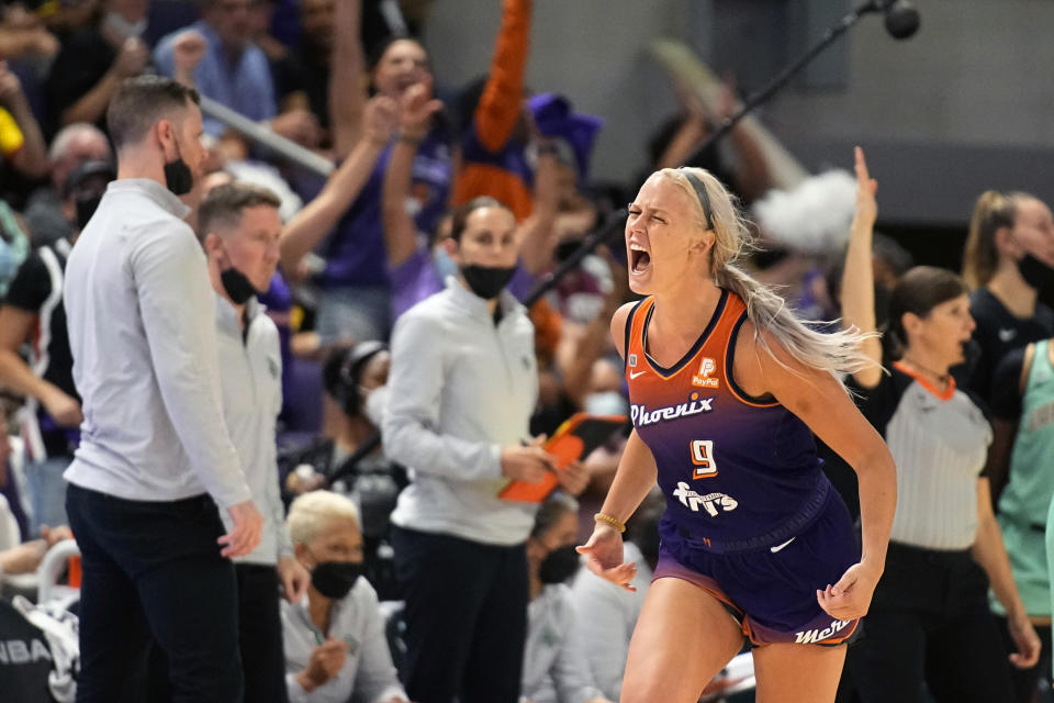 Phoenix Mercury guard Sophie Cunningham (9) reacts after scoring during the second half in the first round of the WNBA basketball playoffs against the Phoenix Mercury, Thursday, Sept. 23, 2021, in Phoenix. Phoenix won 83-82. (AP Photo/Rick Scuteri)
