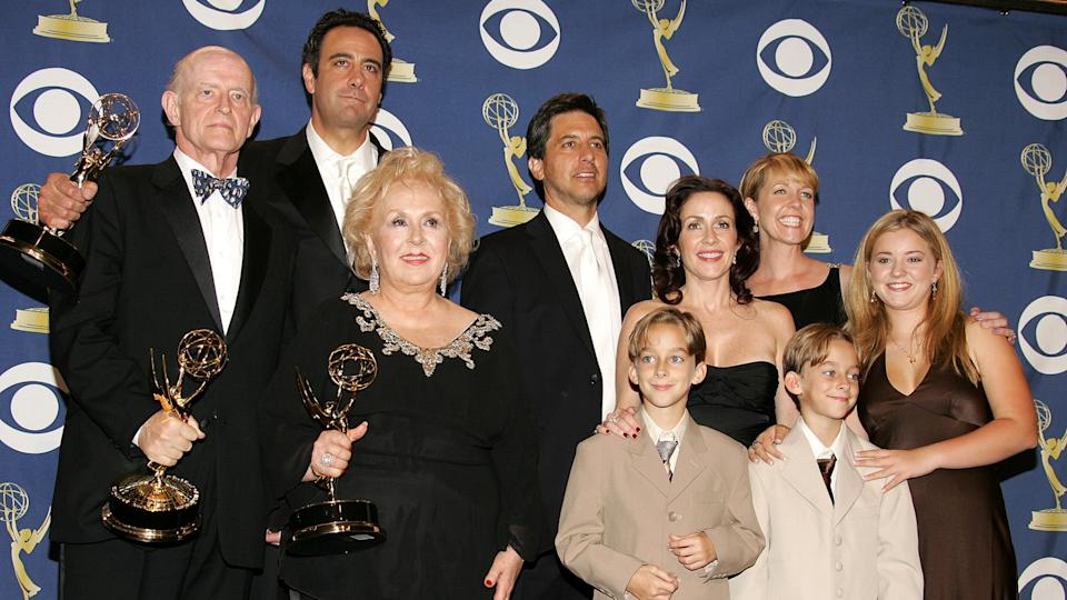 LOS ANGELES, CA - SEPTEMBER 18:  The cast of 'Everybody Loves Raymond', (L-R) Peter Boyle, Brad Garrett, Doris Roberts, Ray Romano, Patricia Heaton, Monica Horan, Sawyer Sweeten, Sullivan Sweeten and Madylin Sweeten pose with the Emmy for Outstanding Comedy Series in the press room at the 57th Annual Emmy Awards held at the Shrine Auditorium on September 18, 2005 in Los Angeles, California.