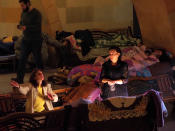People take refuge in an improvised bomb shelter in the separatist region of Nagorno-Karabakh, Friday, Oct. 30, 2020. The Azerbaijani army has closed in on a key town in the separatist territory of Nagorno-Karabakh following more than a month of intense fighting. (AP Photo)
