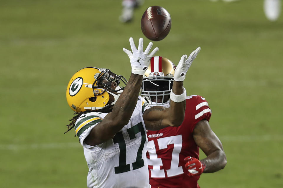 Green Bay Packers wide receiver Davante Adams (17) catches a pass in front of San Francisco 49ers cornerback Jamar Taylor (47) during the second half of an NFL football game in Santa Clara, Calif., Thursday, Nov. 5, 2020. (AP Photo/Jed Jacobsohn)