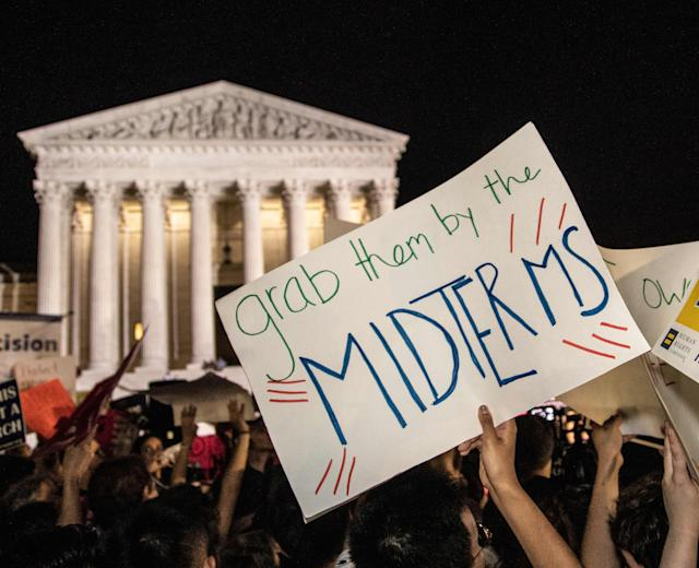 "<p>""Grab them by the midterms"" reads the sign. Hundreds assembled in front of the U.S. Supreme Court in Washington D.C., to protest Brett Kavanaugh, President Donald Trump's nominee to replace Justice Anthony Kennedy, on Monday night, July 9, 2018. (Photo: Jeff Malet/Newscom via ZUMA Press) </p>"