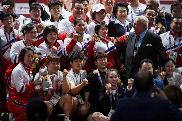 The North Koreans were joined by the South Korean weightlifting team to celebrate the end of the competition with an unprecedented joint team photo. (AFP Photo/CHAIDEER MAHYUDDIN)
