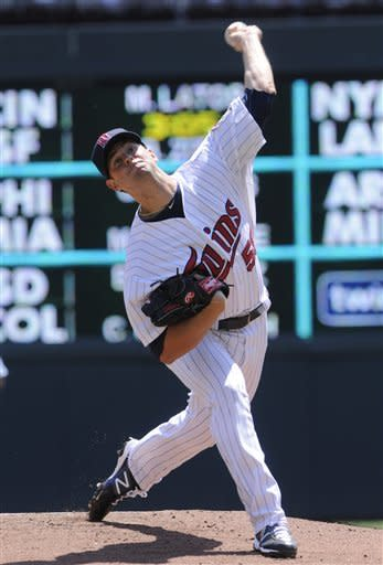 Minnesota Twins starting pitcher Scott Diamond throws against the Kansas City Royals in the first inning in the first baseball game of a doubleheader, Saturday, June 30, 2012 in Minneapolis. (AP Photo/Jim Mone)