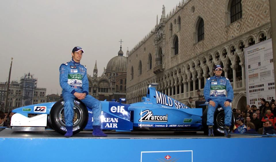 Jenson Button (left) and Giancarlo Fisichella (right) show off the Benetton Formula One team's new car for the 2001 season in St Marks Square, Venice, Italy.