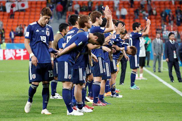 Soccer Football - World Cup - Group H - Japan vs Senegal - Ekaterinburg Arena, Yekaterinburg, Russia - June 24, 2018 Japan players applaud fans after the match REUTERS/Max Rossi