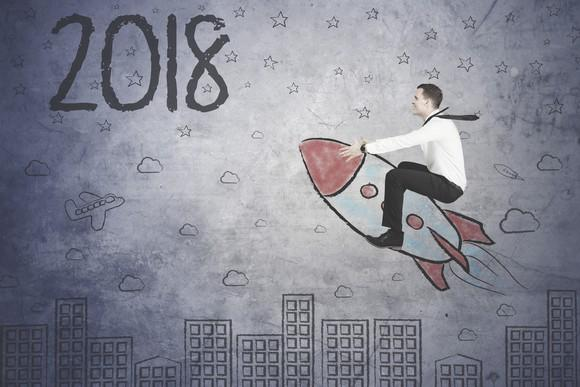 Person riding a rocket toward 2018.