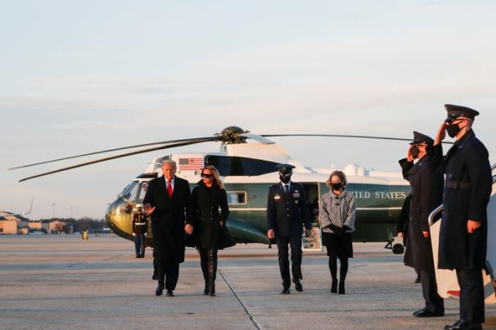 U.S. President Donald Trump boards Air Force One beside first lady Melania Trump at Joint Base Andrews in Maryland