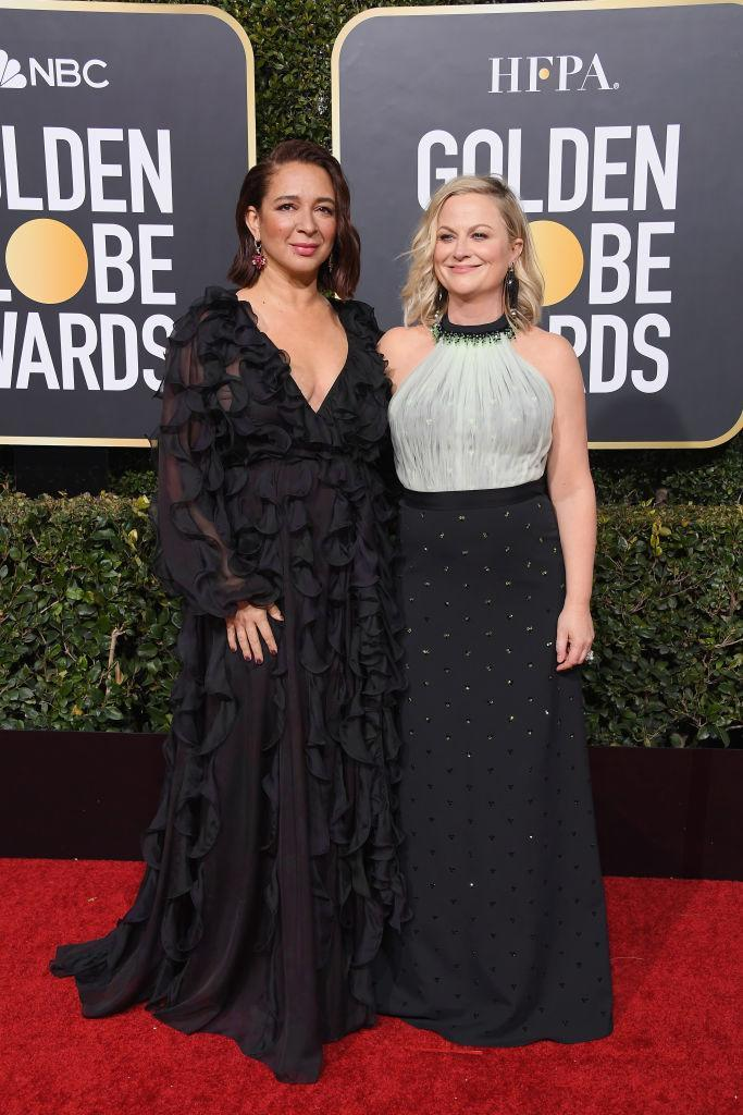 <p>Maya Rudolph, left, and Amy Poehler attend the 76th Annual Golden Globe Awards at the Beverly Hilton Hotel in Beverly Hills, Calif., on Jan. 6, 2019. (Photo: Getty Images) </p>