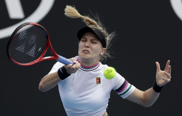 Canada's Eugenie Bouchard hits a forehand return to China's Peng Shuai during their first round match at the Australian Open tennis championships in Melbourne, Australia, Tuesday, Jan. 15, 2019. (AP Photo/Mark Schiefelbein)