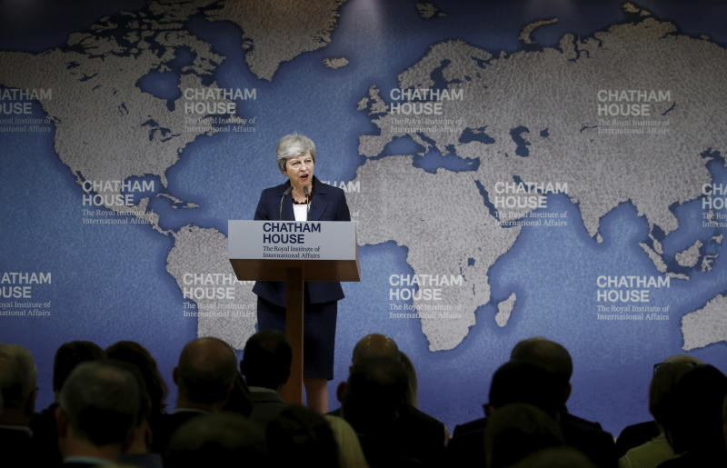"Britain's Prime Minister Theresa May speaks at Chatham House in London, Wednesday July 17, 2019. Prime Minister Theresa May says she worries about the increasing ""absolutism"" of world politics, in a message many will see as aimed at her successor as Britain's leader and President Donald Trump. (Henry Nicholls/Pool via AP)"
