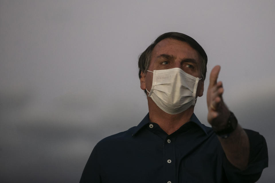 BRASILIA, BRAZIL - JULY 18: Jair Bolsonaro President of Brazil gestures in front of the official residence after testing positive for coronavirus (COVID-19) in Alvorada Palace on July 18, 2020 in Brasilia, Brazil. President Bolsonaro announced Tuesday July 07 he tested positive for COVID-19 after presenting symptoms. (Photo by Bruna Prado/Getty Images)