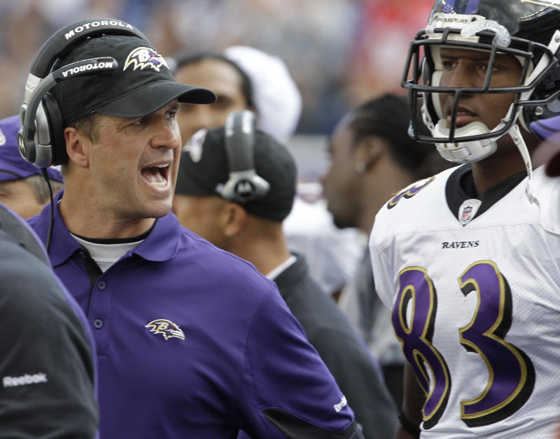 Baltimore Ravens coach John Harbaugh has a word with tight end Ed Dickson (83) during the second half of an NFL football game against the New England Patriots in Foxborough, Mass., Sunday afternoon, Oct. 17, 2010. The Patriots defeated the Ravens 23-20 in overtime. (AP Photo/Stephan Savoia)