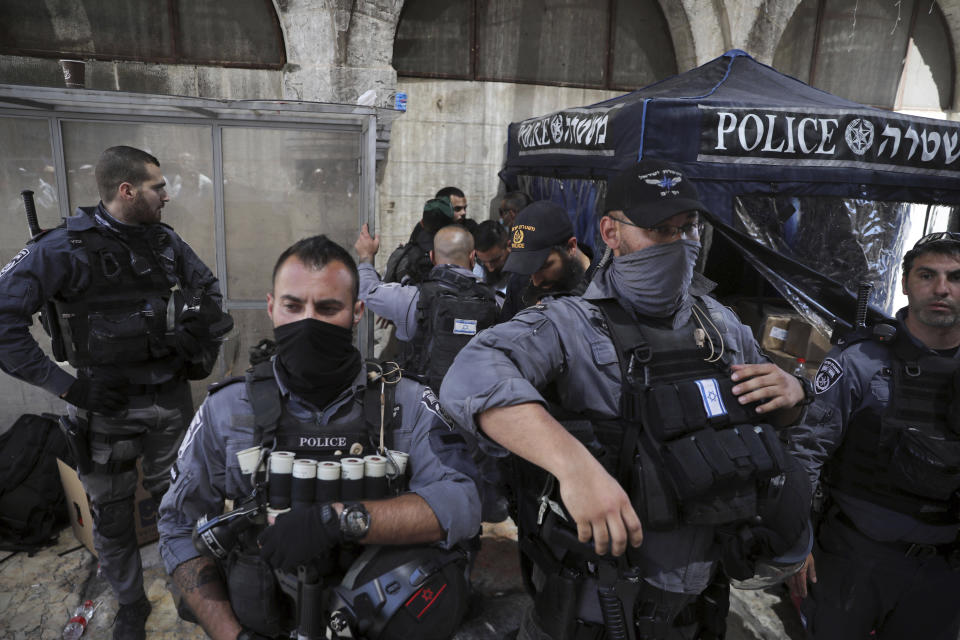 A Palestinian man, background, is searched by Israeli police following a protest against evictions of Palestinians from their homes after the last Friday prayers of the Muslim holy month of Ramadan at the Dome of the Rock Mosque in the Al Aqsa Mosque compound in the Old City of Jerusalem, Jerusalem, Friday, May 7, 2021. (AP Photo/Mahmoud Illean)