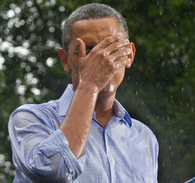 President Barack Obama holds a re-election campaign rally despite the heavy rain at the historic Walkerton Tavern & Gardens in Glen Allen, Va., near Richmond Saturday, July 14, 2012. It is in the Congressional district represented by House Majority Leader Eric Cantor, R-Va., a key county in a crucial swing state of the presidential election. (AP Photo/J. Scott Applewhite)