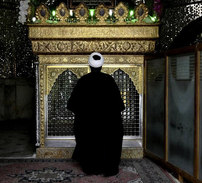 A Shiite cleric prays at the shrine of Saint Ali Akbar, in northern Tehran, Iran, Sunday, June 23, 2013. Hatreds between Shiites and Sunnis are now more virulent than ever in the Arab world because of Syria's brutal civil war. Hard-line clerics and politicians on both sides have added fuel, depicting the fight as essentially a war of survival for their sect. (AP Photo/Vahid Salemi)