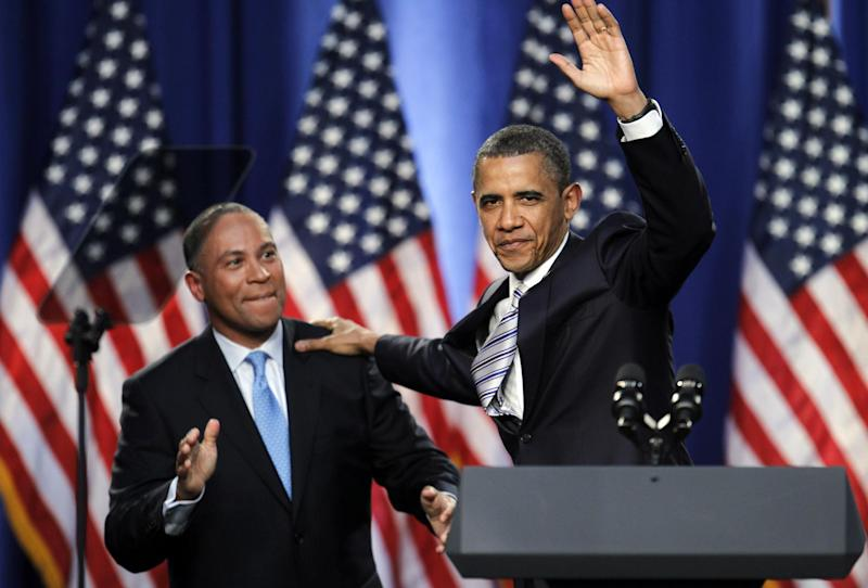 "President Barack Obama, accompanied by Massachusetts Gov. Deval Patrick, waves during a campaign fundraising event in Boston. Don't bet on Mitt Romney winning his home state. Or even trying. ""That's not been a topic of discussion,"" Romney campaign adviser Kevin Madden said when asked if the Republican former Massachusetts governor would compete in the heavily Democratic state. (AP Photo/Steven Senne, File)"