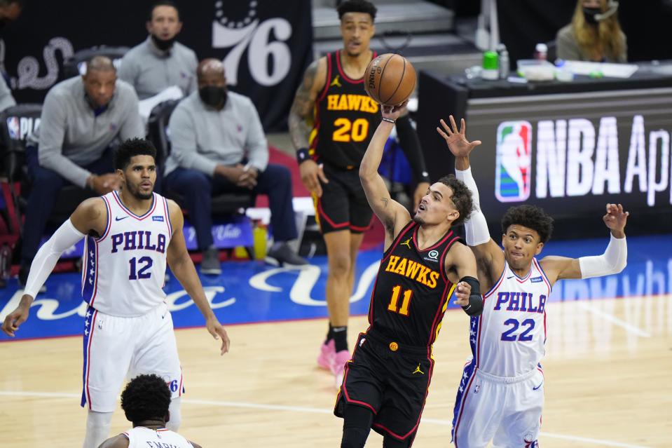 Atlanta Hawks' Trae Young (11) goes up for a shot against Philadelphia 76ers' Matisse Thybulle (22) during the second half of Game 7 in a second-round NBA basketball playoff series, Sunday, June 20, 2021, in Philadelphia. (AP Photo/Matt Slocum)