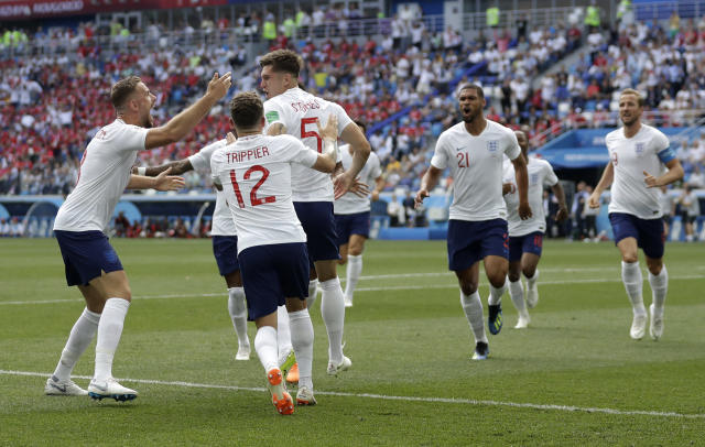 <p>England players run to teammate John Stones after he scored his team's first goal </p>